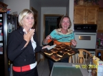 Gail and Kara help with dinner at Chris Julius' house.. their only job was to make sure the garlic bread didn't burn..